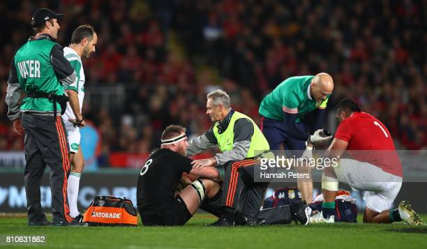 Kieran Read of the All Blacks and Mako Vunipola of the Lions receive treatment during the third test match between the New Zealand All Blacks and the...