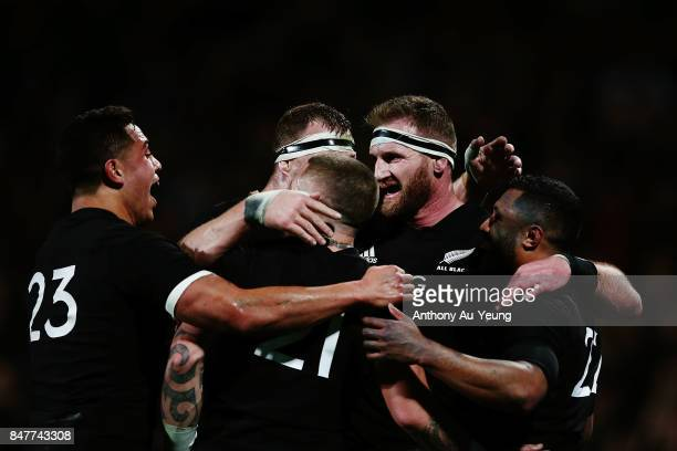 Kieran Read of the All Blacks celebrates with teammates on Lima Sopoaga's try during the Rugby Championship match between the New Zealand All Blacks...