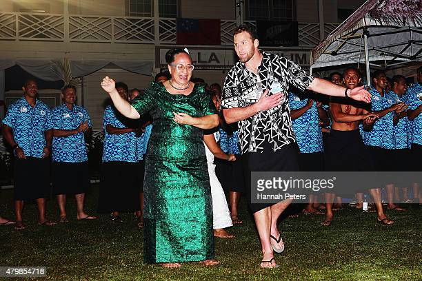 Kieran Read of the All Blacks dances with the Samoan team at the post match function following the International Test match between Samoa and the New...