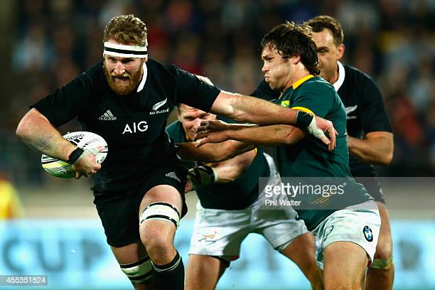 Kieran Read of the All Blacks is tackled during The Rugby Championship match between the New Zealand All Blacks and the South Africa Springboks at...