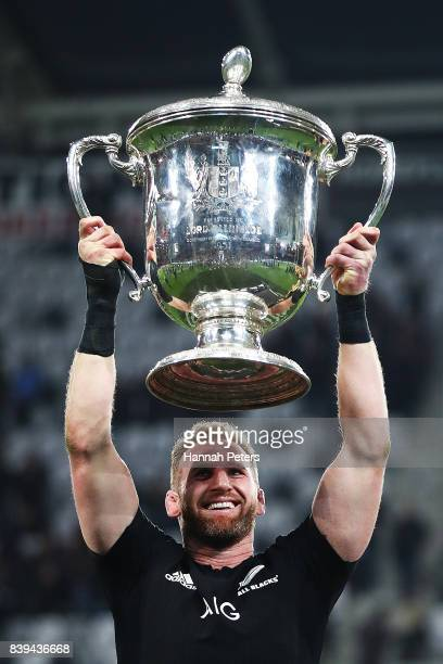 Kieran Read of the All Blacks lifts the Bledisloe Cup after winning The Rugby Championship Bledisloe Cup match between the New Zealand All Blacks and...