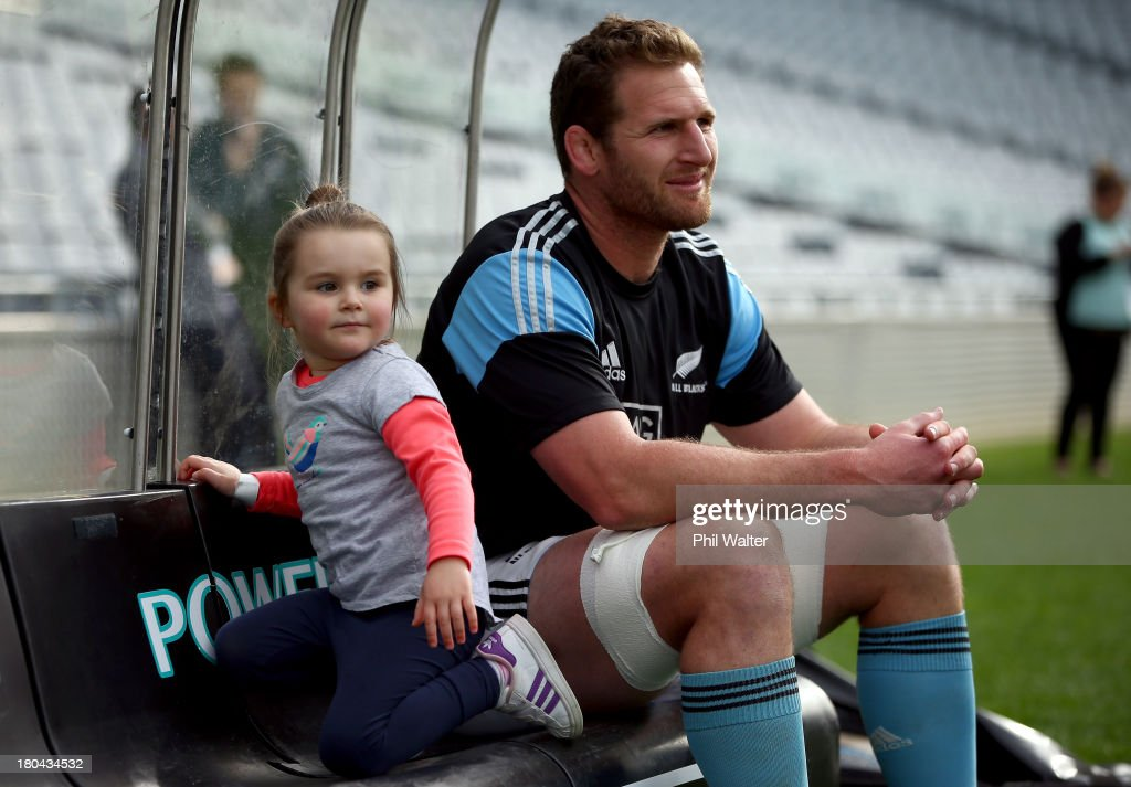 Kieran Read of the All Blacks sits with his daughter Elle during the New Zealand All Blacks captain's run at Eden Park on September 13 2013 in...