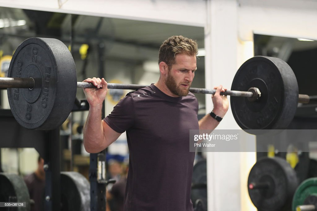 Kieran Read of the All Blacks squats during a gym session at Les Mills on May 30, 2016 in Auckland, New Zealand.