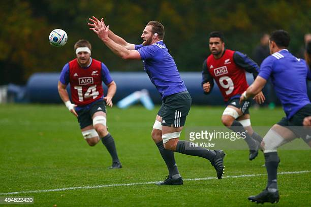 Kieran Read of the All Blacks takes a pass during a New Zealand All Blacks training session on October 29 2015 in Bagshot United Kingdom