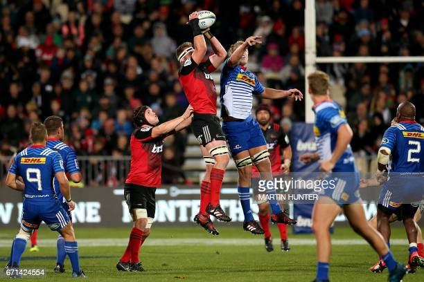 Kieran Read of the Canterbury Crusaders catches the ball next to Eben Etzebeth of the Western Stormers during the Super Rugby match between New...