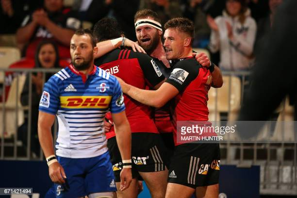Kieran Read of the Canterbury Crusaders celebrates with teammates after scoring a try during the Super Rugby match between New Zealand's Canterbury...