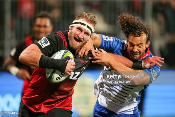 Kieran Read of the Canterbury Crusaders pushes off Dillyn Leyds of the Western Stormers to score a try during the Super Rugby match between New...