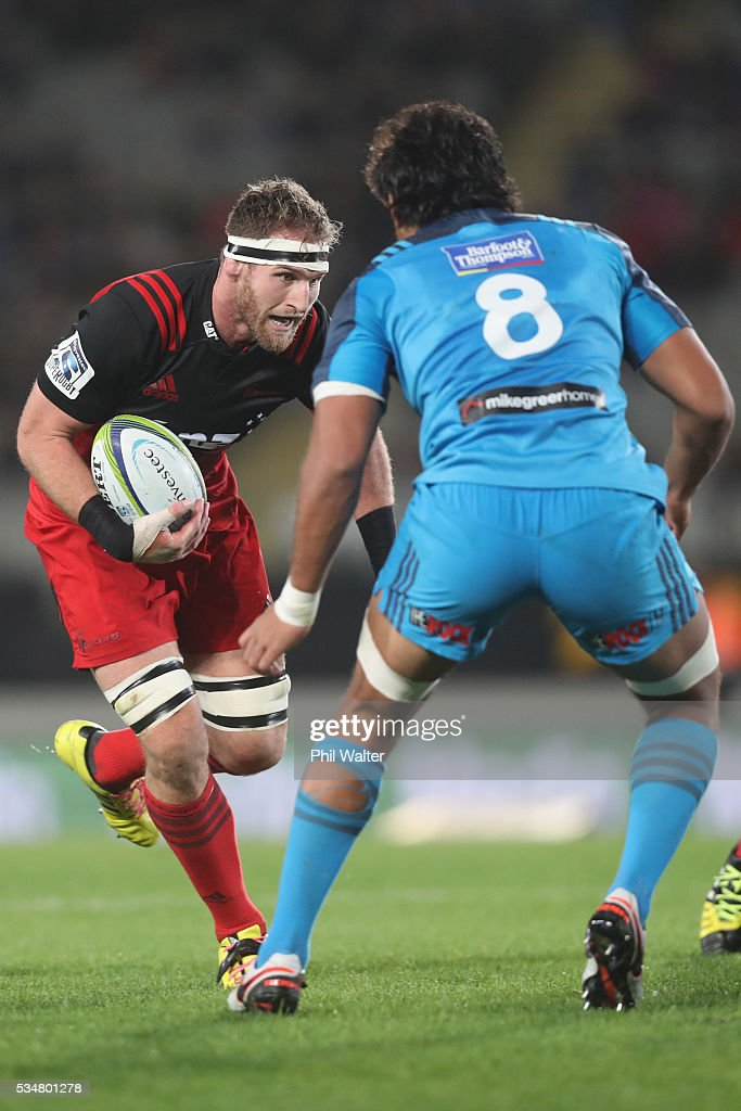 <a gi-track='captionPersonalityLinkClicked' href=/galleries/search?phrase=Kieran+Read&family=editorial&specificpeople=789465 ng-click='$event.stopPropagation()'>Kieran Read</a> of the Crusaders charges at <a gi-track='captionPersonalityLinkClicked' href=/galleries/search?phrase=Steven+Luatua&family=editorial&specificpeople=6164979 ng-click='$event.stopPropagation()'>Steven Luatua</a> of the Blues during the round 14 Super Rugby match between the Blues and the Crusaders at Eden Park on May 28, 2016 in Auckland, New Zealand.