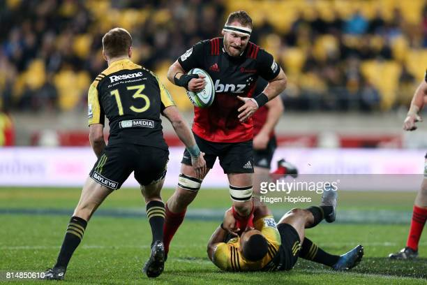 Kieran Read of the Crusaders is tackled by Ngani Laumape of the Hurricanes during the round 17 Super Rugby match between the Hurricanes and the...