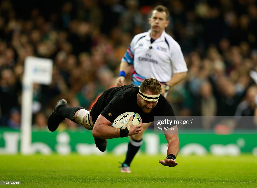 Kieran Read of the New Zealand All Blacks dives over to score his team's seventh try during the 2015 Rugby World Cup Quarter Final match between New...