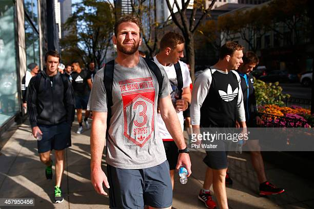 Kieran Read of the New Zealand All Blacks takes in a bit of sightseeing as they walk along Michigan Ave following a pool recovery session on October...