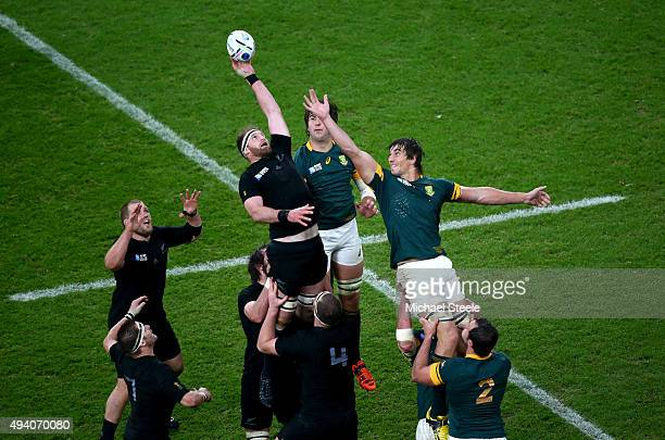 Kieran Read of the New Zealand All Blacks wins the ball in a lineout from Eben Etzebeth of South Africa during the 2015 Rugby World Cup Semi Final...