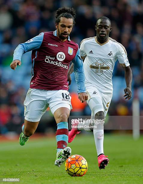 Kieran Richardson of Aston Villa and Modou Barrow of Swansea City compete for the ball during the Barclays Premier League match between Aston Villa...