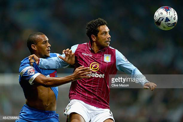 Kieran Richardson of Aston Villa holds off a challenge from Marvin Bartley of Leyton Orient during the Capital One Cup second round match between...