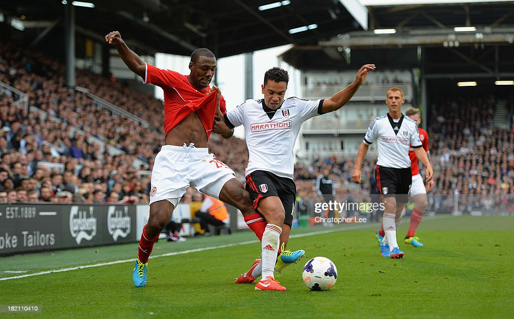 <a gi-track='captionPersonalityLinkClicked' href=/galleries/search?phrase=Kieran+Richardson+-+Soccer+Player&family=editorial&specificpeople=208833 ng-click='$event.stopPropagation()'>Kieran Richardson</a> of Fulham battles with Kevin Theophile-Catherine of Cardiff during the Barclays Premier League match between Fulham and Cardiff City at Craven Cottage on September 28, 2013 in London, England.