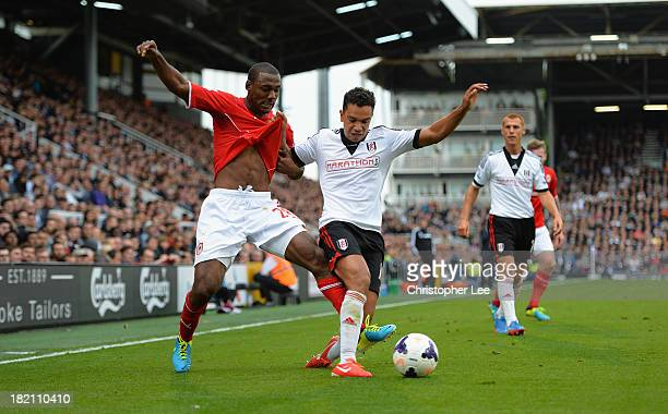 Kieran Richardson of Fulham battles with Kevin TheophileCatherine of Cardiff during the Barclays Premier League match between Fulham and Cardiff City...