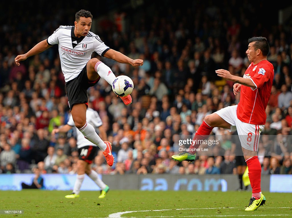 <a gi-track='captionPersonalityLinkClicked' href=/galleries/search?phrase=Kieran+Richardson+-+Soccer+Player&family=editorial&specificpeople=208833 ng-click='$event.stopPropagation()'>Kieran Richardson</a> of Fulham controls the ball in the air from <a gi-track='captionPersonalityLinkClicked' href=/galleries/search?phrase=Gary+Medel&family=editorial&specificpeople=4123504 ng-click='$event.stopPropagation()'>Gary Medel</a> of Cardiff during the Barclays Premier League match between Fulham and Cardiff City at Craven Cottage on September 28, 2013 in London, England.