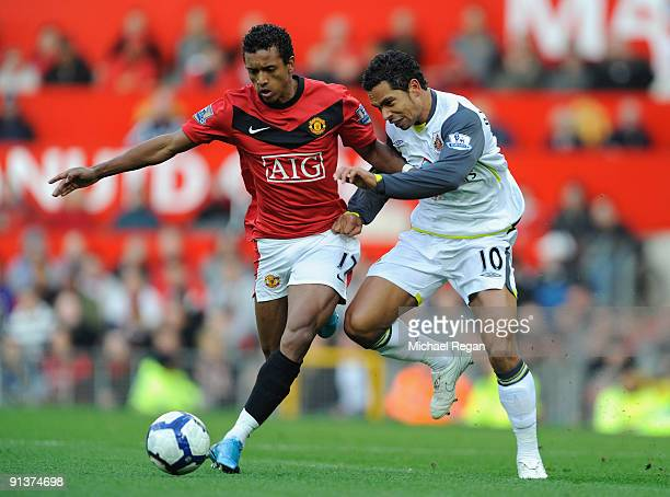 Kieran Richardson of Sunderland battles for the ball with Nani of Manchester United during the Barclays Premier League match between Manchester...