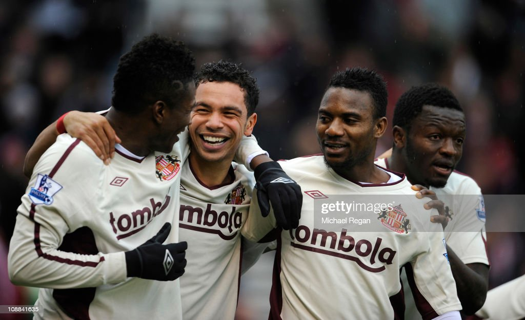 <a gi-track='captionPersonalityLinkClicked' href=/galleries/search?phrase=Kieran+Richardson+-+Voetballer&family=editorial&specificpeople=208833 ng-click='$event.stopPropagation()'>Kieran Richardson</a> of Sunderland celebrates scoring to make it 1-0 with team mates <a gi-track='captionPersonalityLinkClicked' href=/galleries/search?phrase=Asamoah+Gyan&family=editorial&specificpeople=535782 ng-click='$event.stopPropagation()'>Asamoah Gyan</a> and Stephane Sessegnon during the Barclays Premier League match between Stoke City and Sunderland at the Britannia Stadium on February 5, 2011 in Stoke on Trent, England.