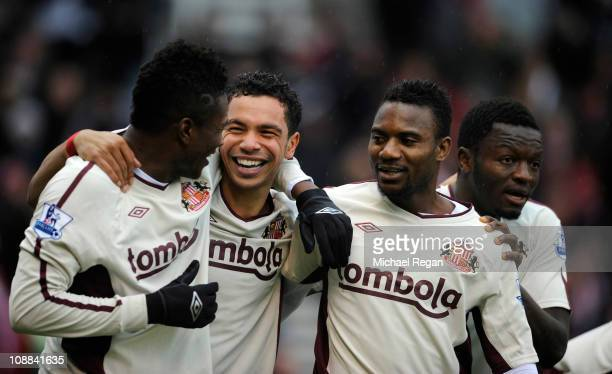 Kieran Richardson of Sunderland celebrates scoring to make it 10 with team mates Asamoah Gyan and Stephane Sessegnon during the Barclays Premier...