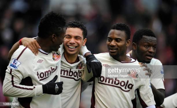 Kieran Richardson of Sunderland celebrates scoring to make it 10 with team mates Asamoah Gyan and Stephane Sessegnon during the Barclays Premier...