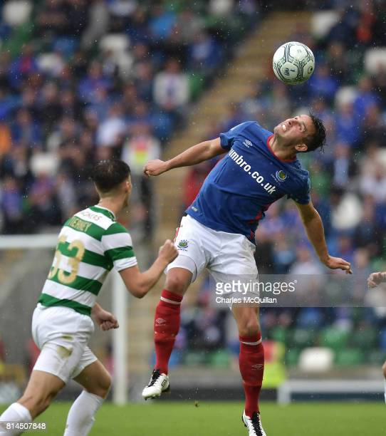Kieran Tierney of Celtic and Andrew Waterworth of Linfield during the Champions League second round first leg qualifying game between Linfield and...