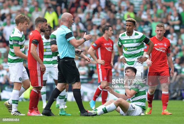 Kieran Tierney of Celtic sits on the turf with a facial injury that forced him to be substituted in the first half during the William Hill Scottish...