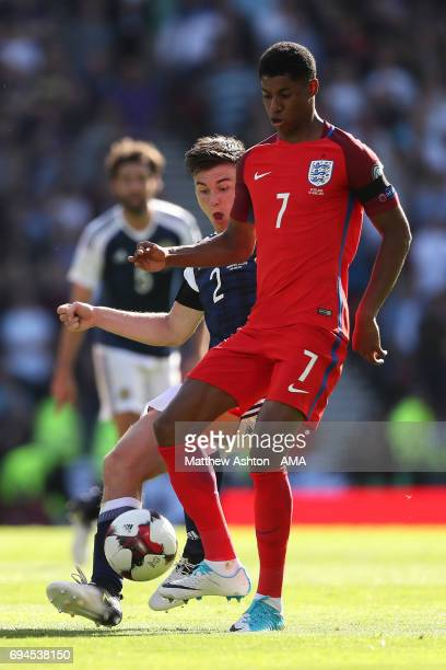 Kieran Tierney of Scotland competes with Marcus Rashford of England during the FIFA 2018 World Cup Qualifier between Scotland and England at Hampden...