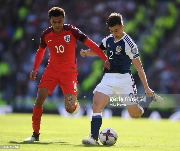 Kieran Tierney of Sotland is challenged by Dele Alli of England during the FIFA 2018 World Cup Qualifier between Scotland and England at Hampden Park...