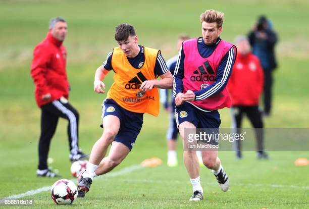 Kieran Tierney vies with Stuart Armstrong during a training session at Mar Hall on March 23 2017 in Erskine Scotland