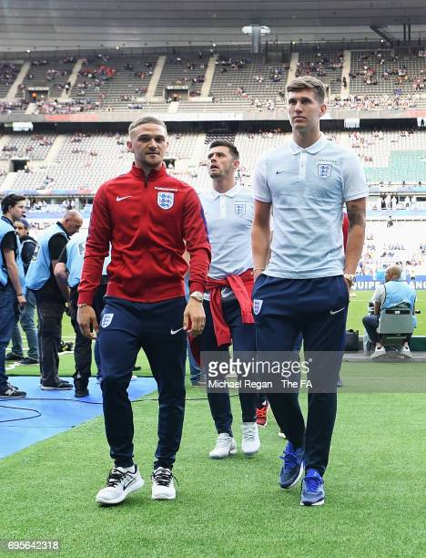 Kieran Trippier Aaron Cresswell and John Stones of England walk down the tunnel prior to the International Friendly match between France and England...