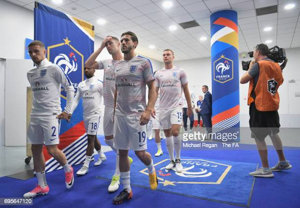 Kieran Trippier and Adam Lallana of England walk out the tunnel with team mates prior to the International Friendly match between France and England...