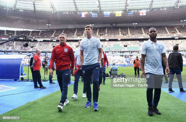 Kieran Trippier John Stones and Raheem Sterling of England walk down the tunnel prior to the International Friendly match between France and England...
