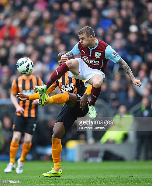 Kieran Trippier of Burnley challenges Sone Aluko of Hull City during the Barclays Premier League match between Hull City and Burnley at KC Stadium on...