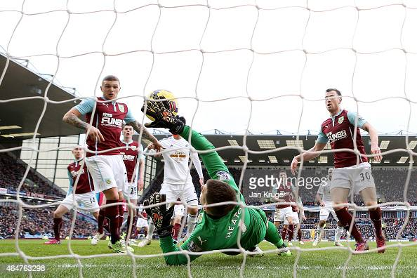 Kieran Trippier of Burnley scores an own goal past goalkeeper Thomas Heaton of Burnley during the Barclays Premier League match between Burnley and...