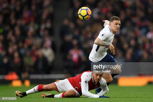 Kieran Trippier of Tottenham Hotspur and Alexis Sanchez of Arsenal in action during the Premier League match between Arsenal and Tottenham Hotspur at...