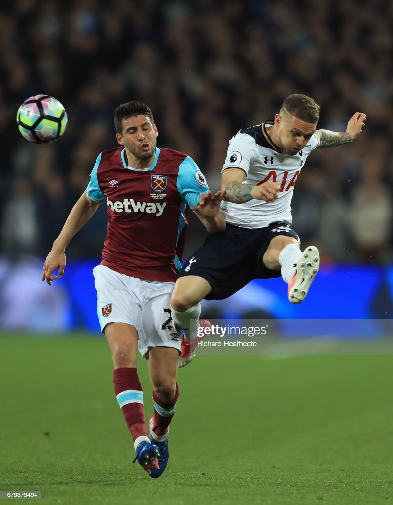Kieran Trippier of Tottenham Hotspur clears the ball under pressure from Jonathan Calleri of West Ham United during the Premier League match between West Ham United and Tottenham Hotspur at the London Stadium on May 5, 2017 in Stratford, England.
