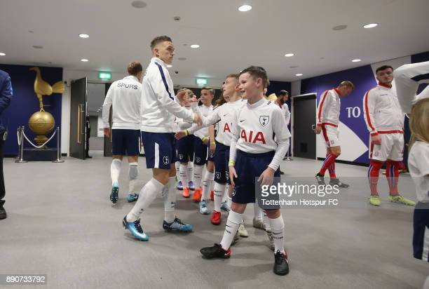 Kieran Trippier of Tottenham Hotspur greets the mascots in the tunnel prior to the Premier League match between Tottenham Hotspur and Stoke City at...