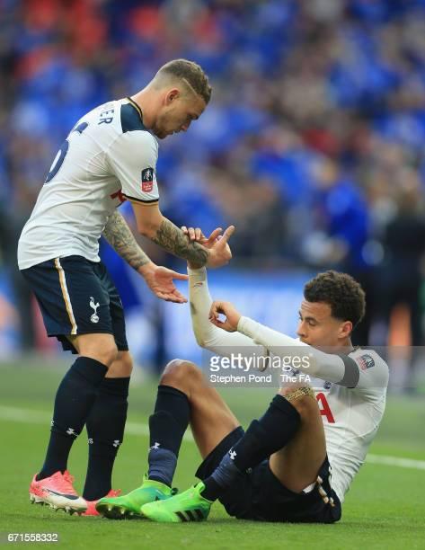 Kieran Trippier of Tottenham Hotspur helps up Dele Alli of Tottenham Hotspur during The Emirates FA Cup SemiFinal between Chelsea and Tottenham...