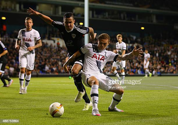 Kieran Trippier of Tottenham Hotspur holds off Reynaldo of FK Qarabag during the UEFA Europa League Group J match between Tottenham Hotspur FC and...