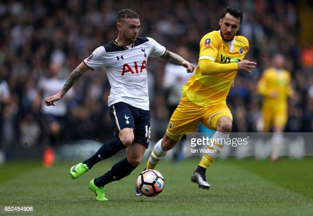 Kieran Trippier of Tottenham Hotspur is put under pressure from Lee Gregory of Millwall during The Emirates FA Cup QuarterFinal match between...