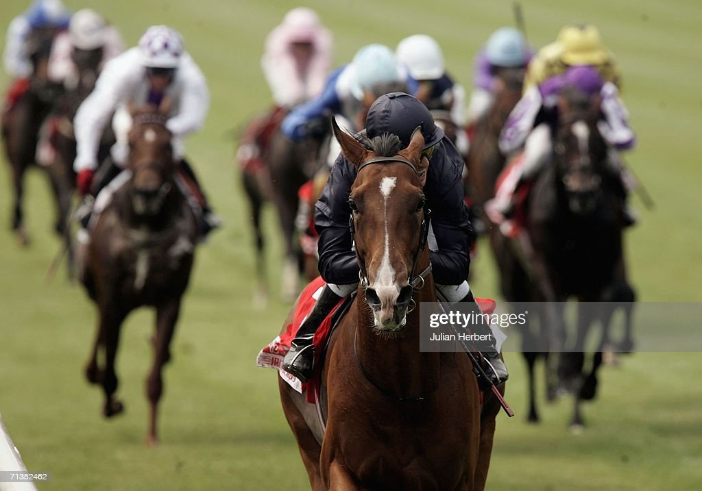 Kieren Fallon and Dylan Thomas land The Budweiser Irish Derby run at The Curragh Racecourse on July 2 2006 at The Curragh Ireland