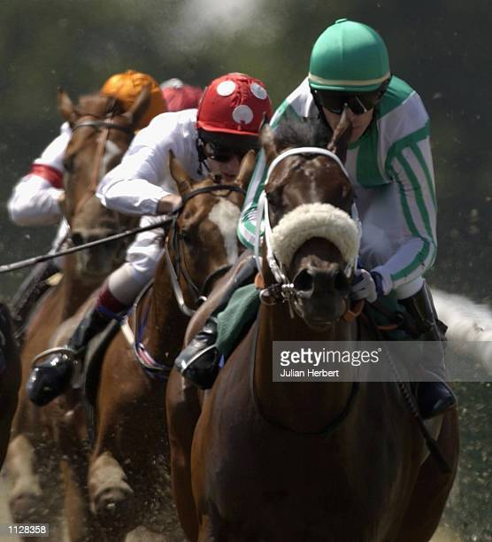 Kieren Fallon and Elusive City land The EBF Maiden Stakes run at Lingfield Park Racecourse in Lingfield on July 17 2002