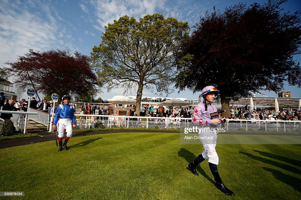 Kieren Fallon and Frankie Dettori make their way into the parade ring at York racecourse on May 12 2016 in York England
