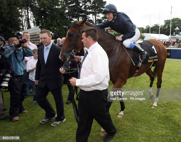 Kieren Fallon celebrates with Dylan Thomas after their victory in the Tattersalls Millions Irish Champion Stakes at Leopardstown Racecourse Dublin...