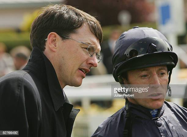 Kieren Fallon chats to trainer Aidan O'Brien after Gypsy King landed The Dee Stakes Race run at Chester Racecourse on May 6 2005 at Chester England