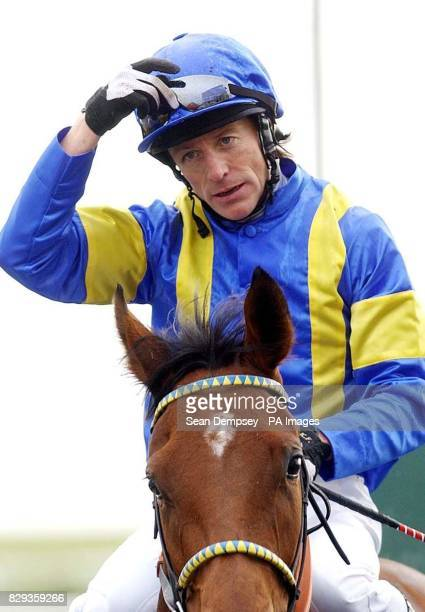 Kieren Fallon on Hallowed Dream is led in after competing in the Heathavon Stud Houghton Conditions Stakes at Newmarket at Newmarket