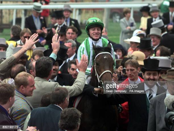 Kieren Fallon on Oath heads for the winning enclosure after winning the Vodafone Derby at Epsom
