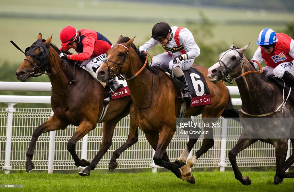Kieren Fallon rides Drunken Sailor on his way to winning The Coutts Glorious Stakes from Harris Tweed at Goodwood racecourse on July 29 2011 in...