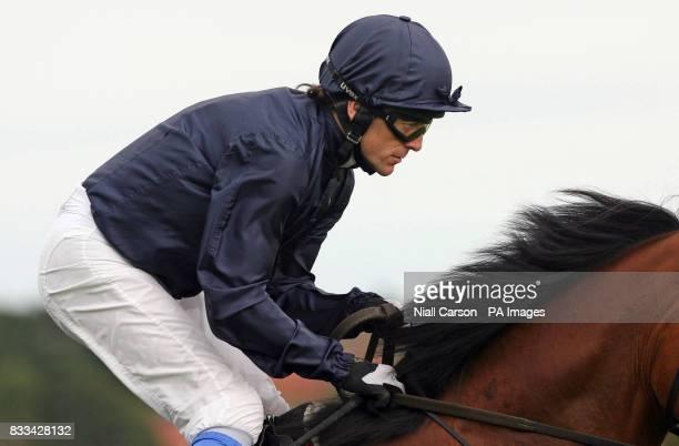 Kieren Fallon rides Dylan Thomas to victory in the Tattersalls Millions Irish Champion Stakes at Leopardstown Racecourse Dublin Ireland